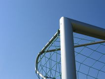 Soccer Goal Angle. Upper left angle of an silver soccer goal with a green net Royalty Free Stock Photos