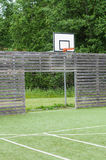 Soccer goal and basketball hoop on outdoor playground Royalty Free Stock Image