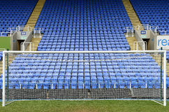 Soccer goal and blue seats Royalty Free Stock Photography