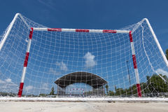 Soccer goal .Clear sky, blue cement cour Stock Photography