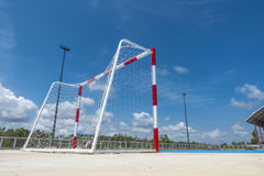 Soccer goal Clear sky, blue cement cour Royalty Free Stock Photos