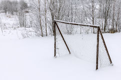 Soccer goal covered with snow. Old abandoned wooden soccer goal covered with snow during winter season Royalty Free Stock Photography