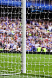 Soccer goal and crowd. A goal and net with an expectant crowd waiting Stock Image