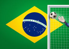 Soccer goal with flag from brazil Royalty Free Stock Images