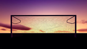 Soccer goal on the football field. At sunset Royalty Free Stock Photo