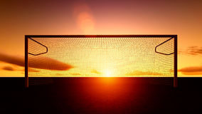 Soccer goal on the football field. At sunset Stock Images