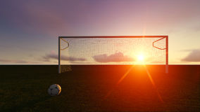 Soccer goal on the football field. At sunset Royalty Free Stock Photography