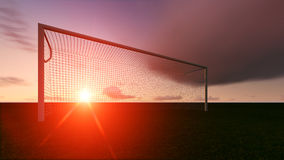 Soccer goal on the football field. At sunset Royalty Free Stock Image