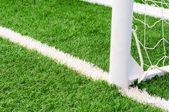 Soccer goal football on green grass field.  Stock Photo