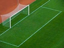 Soccer goal gate. Empty goal gates on a green grass on a soccer stadium Royalty Free Stock Photos