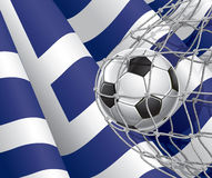 Soccer Goal. Greek flag with a soccer ball. Royalty Free Stock Images