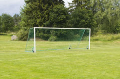Soccer goal on green grass Royalty Free Stock Images
