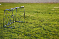 Soccer goal on green grass royalty free stock photography