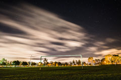 Soccer Goal on Green Lawn Field Under Cloudy Skies Royalty Free Stock Image