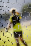 Soccer Goal Net. Football soccer goal net with grass and abstract goalie background Royalty Free Stock Photo