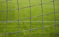 Soccer goal net. Green grass and white line Stock Image