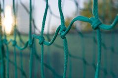 Soccer goal net. Closeup with evening sunlight Royalty Free Stock Photography