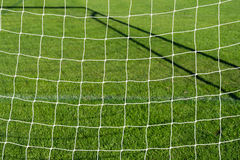 Soccer goal net with grass background. Soccer goal net with green grass background Royalty Free Stock Images