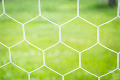 Soccer Goal Net with Green Grass. Background Royalty Free Stock Photos