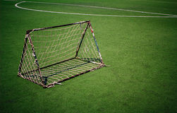 Soccer goal net. In the the plastic sports field Royalty Free Stock Photography