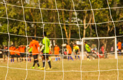 Soccer goal net. With the player background Royalty Free Stock Image