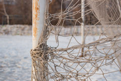 Soccer goal net in the winter in the city. In the daytime Stock Photos