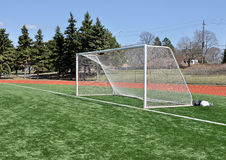 Soccer Goal Posts. Goal posts on astroturf field under blue sky Royalty Free Stock Photography