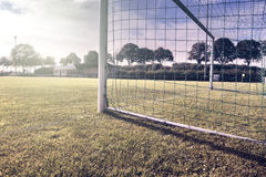 Soccer goal on summer field Royalty Free Stock Image