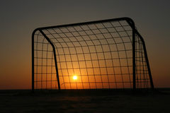 Soccer Goal at Sunset. A metal soccer goal silhouetted against a sunset Stock Photos