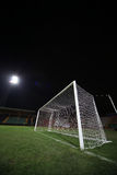 Soccer goal under floodlight Stock Image