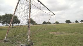 Soccer goal. Weathered​ old soccer goal on practice field at the park Royalty Free Stock Image