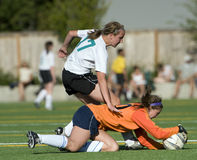 Soccer goalie collision Stock Photo