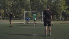 Soccer goalie conceding a goal from penalty kick. Frustrated football goalkeeper conceding a goal from penalty kick during soccer match, expressing despair and stock video