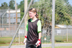 Soccer goalie on field. Young soccer player in goalie position Stock Image