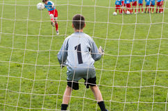 Soccer goalie. Young soccer goalie in action Stock Photo