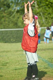 Soccer Goalie/Young Girl. A cute young soccer goalie signaling to her team Stock Photography