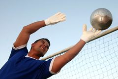 Soccer Goalkeeper. Stretching to stop the ball Stock Photo