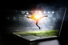 Soccer goalkeeper in action. Mixed media Royalty Free Stock Images