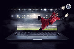 Soccer goalkeeper in action. Mixed media Royalty Free Stock Photography