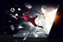 Soccer goalkeeper in action. Mixed media Stock Images