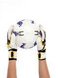 Soccer goalkeeper with ball in his hand on white background Stock Image