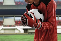 Soccer goalkeeper catch the ball Stock Images