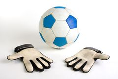 Soccer goalkeeper gloves. Photo from soccer ball and the goalkeeper gloves. White background royalty free stock photography