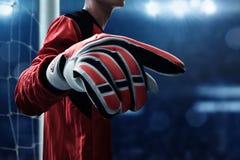 Soccer goalkeeper gloves on the fields stock photography