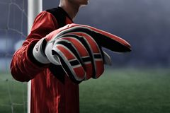 Soccer goalkeeper gloves on the field royalty free stock photography
