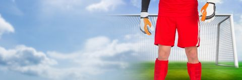 Soccer goalkeeper in goal with transition. Digital composite of Soccer goalkeeper in goal with transition stock images