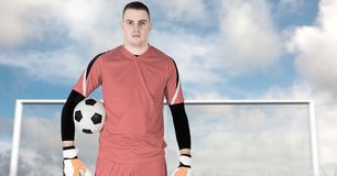 Soccer goalkeeper holding ball in goal. Digital composite of Soccer goalkeeper holding ball in goal stock photography