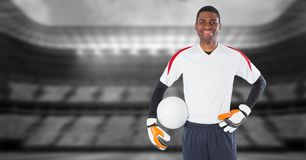 Soccer goalkeeper holding football in goal. Digital composite of Soccer goalkeeper holding football in goal royalty free stock image