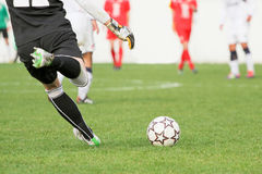 Soccer goalkeeper kick the ball Royalty Free Stock Photo
