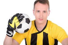 Soccer. Goalkeeper plays with the ball. Isolated on white background royalty free stock image